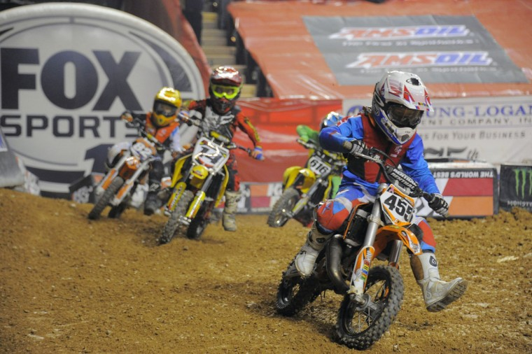 Xander Brion, 8, leads the pack on his way to victory during an Arenacross race at the Baltimore Arena, Jan. 11, 2014. (Karl Merton Ferron/Baltimore Sun Photo)