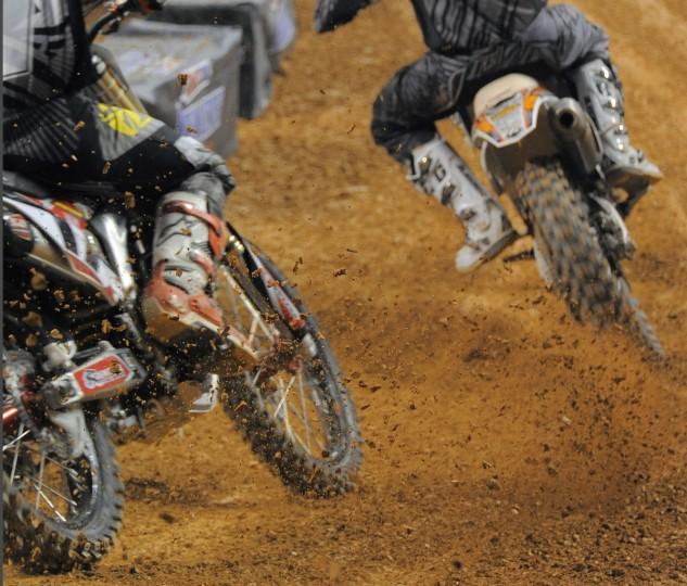 Bikes kick up dirt in the second heat of an Arenacross race at the Baltimore Arena, Jan. 11, 2014. (Karl Merton Ferron/Baltimore Sun Photo)