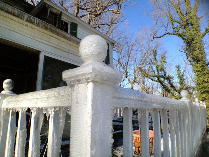 Ice coats the railing of a deck a day after firefighters battled the fire that gutted the late-18th century home. (Karl Merton Ferron/Baltimore Sun)