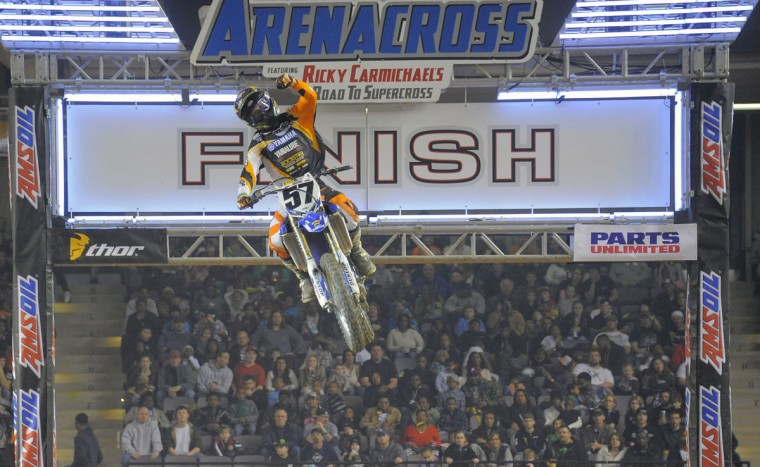 Aaron Plessinger punches the sky at the finish line during the AMSOIL Arenacross race at Baltimore Arena, Jan. 11, 2014. (Karl Merton Ferron/Baltimore Sun Photo)