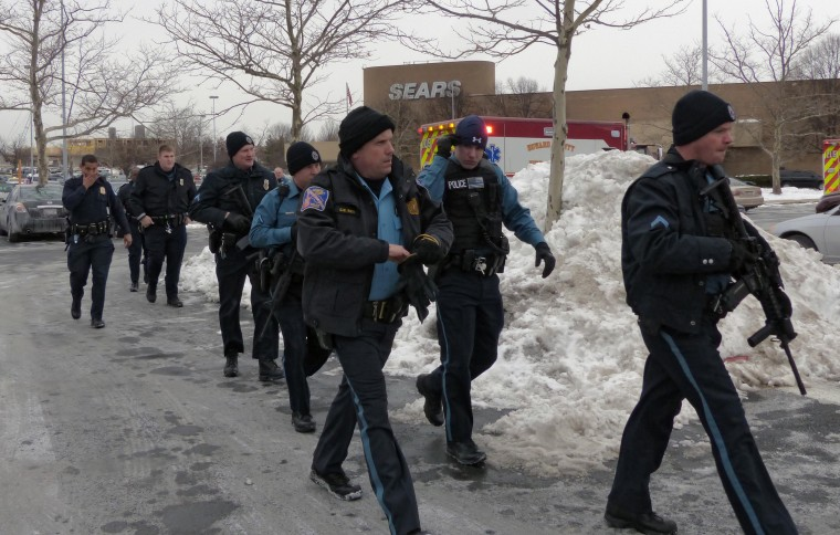 Police deploy during a shooting inside the Columbia Mall Saturday, Jan. 25, 2014. At least three people are confirmed dead, including the shooter, according to news reports claiming police as the source of the information. (Karl Merton Ferron/Baltimore Sun Staff)