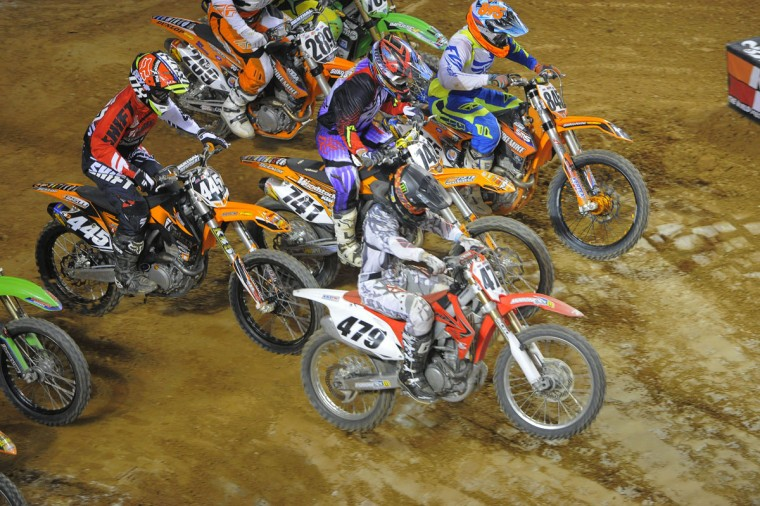Bikes break out of the starting gate during the Baltimore Arenacross event at the Baltimore Arena, Jan. 11, 2014. (Karl Merton Ferron/Baltimore Sun Photo)