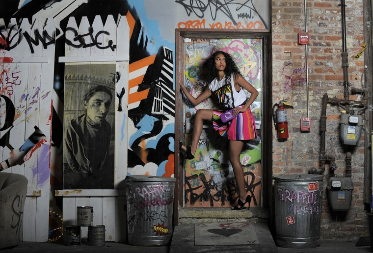 Jessa in a Regency t-shirt, $38, and As Is skirt, $98, Hello Kitty clutch, $22, earrings, $28, ring, $19, necklace, $44, all from Katwalk Boutique; L.K. Bennett heels, Sassaonva, $395. (Lloyd Fox/Baltimore Sun staff)