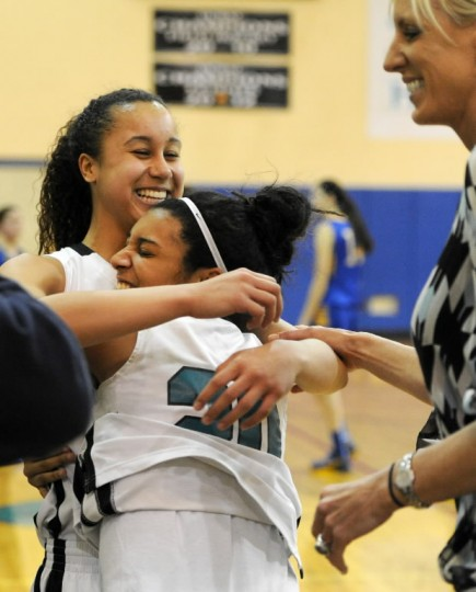 Patterson Mill's Qalea Ismail, left, gets a big hug from teammate Sia Barnes after Ismail scored her 1,000th career point on a foul shot in the fourth quarter during a girls basketball game against Aberdeen on Jan. 28. (Photo by Matt Button/BSMG)