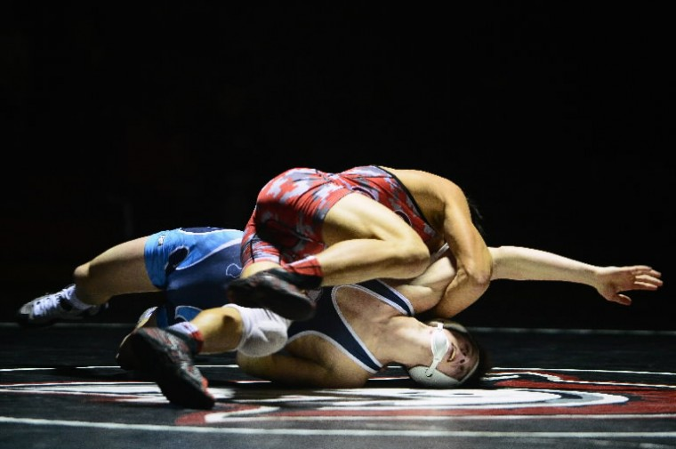 River Hill's Ryan Erskine, bottom, is put to the mat by Glenelg's Michael Autry during a wrestling meet at Glenelg High School on Jan. 28. (Photo by Matt Hazlett/BSMG)