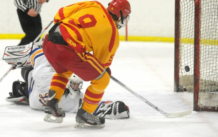 Loyola goalie Robert Weigman can only watch as a shot by Calvert Hall's Costa Pizanis crosses the goal line for a first period score during an ice hockey game for the Brother Andrew Cup at the Reisterstown Sportplex on Thursday, Jan 30. (Photo by Brian Krista/BSMG)
