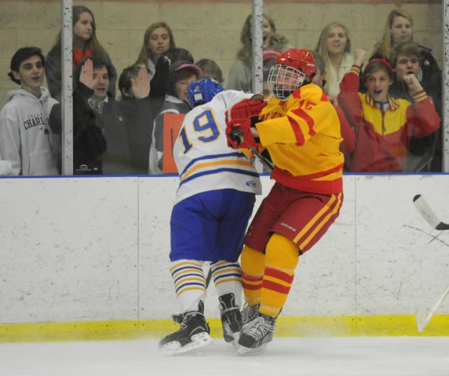 Fans cheer as Loyola's Austin Kesselring, left, and Calvert Hall's Ian McElwee collide on the ice during an ice hockey game for the Brother Andrew Cup at the Reisterstown Sportplex on Thursday, Jan 30. (Photo by Brian Krista/BSMG)