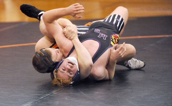 McDonogh's Bobby Twigg, left, forces Mount St. Joseph's Justin Langeluttig onto his back in the 152 pound weight class during a wrestling meet at McDonogh School on Friday, Jan 31. (Photo by Brian Krista/BSMG)
