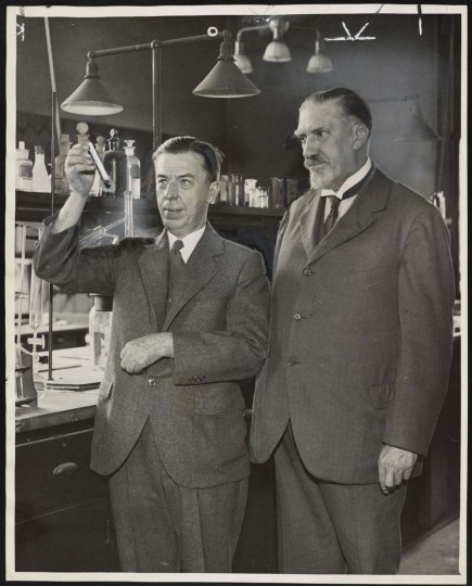"American Experience: Chief Toxicologist Alexander Gettler holds a test tube, while Dr. Charles Norris looks on. Their story is part of the ""American Experience: The Poisoner's Handbook"" on PBS, January 7, 2014. (Courtesy of the Library of Congress/MCT)"