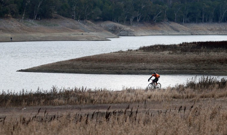 A bicyclist rides in an area that was previously underwater at Lexington Reservoir in Los Gatos, Calif., Jan. 8, 2014. The water level is very low due to the ongoing drought. (Patrick Tehan//MCT)