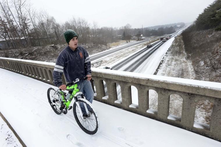 Sean Parisi, 16, a junior at South Caldwell High School pushes his bike along the Falls Ave. Bridge in Granite Falls, N.C., on Tuesday, Jan. 28, 2014. (Robert Lahser/Charlotte Observer/MCT)