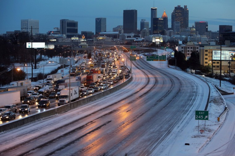 As dawn breaks early Wednesday south of Downtown Atlanta, the Connector Southbound is clogged with traffic, as the Connector Northbound is an empty sheet of ice. (Ben Gray/Atlanta Journal-Constitution/MCT)