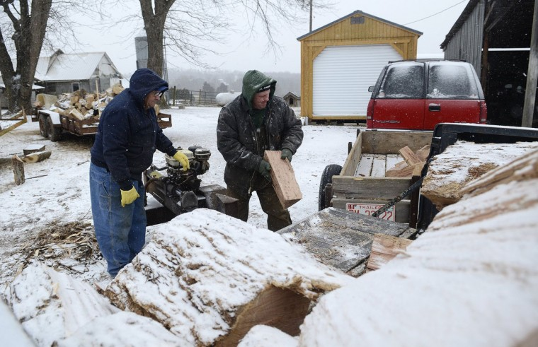 James Galliher, 69, helps his son Todd Galliher, 47, as the pair spent a chilly afternoon splitting wood on their grain and cattle farm near Harmony, N.C., on Tuesday, Jan. 28, 2014. (John D. Simmons/Charlotte Observer/MCT)