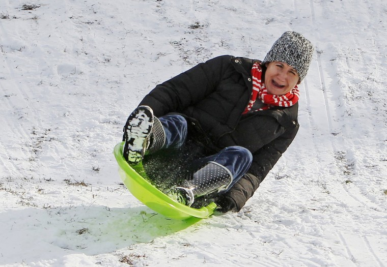 Janie Quinn enjoys the snow at Crayton Middle School in Columbia, S.C., Wednesday, Jan. 29, 2014. (Gerry Melendez/The State/MCT)