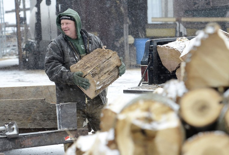 Todd Galliher, 47, spent a chilly afternoon splitting wood on his grain and cattle farm near Harmony, N.C., on Jan. 28, 2014. (John D. Simmons/Charlotte Observer/MCT)