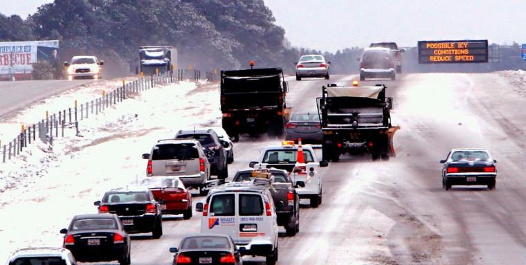 Motorists on I-20 follow snow plow trucks near Highway 6 near Lexington, S.C., Wednesday, Jan. 29, 2014. (Tim Dominick/The State/MCT)