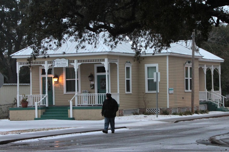Larry Gibson walks down Hopkins Boulevard in Biloxi, Miss. Gibson, who moved from Texas a month ago, was going to take a photo of the ice on the beach. (John Fitzhugh/Biloxi Sun Herald/MCT)