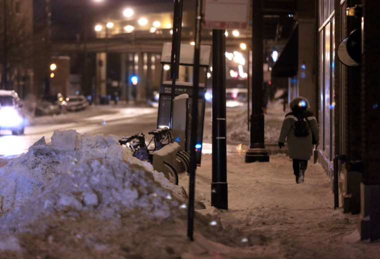 A woman runs for the bus near 18th and Michigan in Chicago. The last time Chicago was this cold was February 1996, according to Accuweather.com. (Heather Charles/Chicago Tribune/MCT)