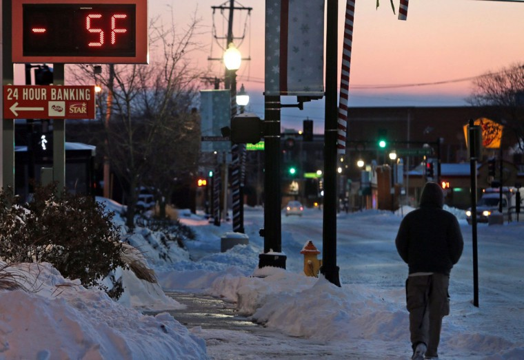 A temperature sign at Citizen's Bank reports -5 degrees as a pedestrian makes his way through the early morning cold in Maplewood, Mo. (Laurie Skrivan/St. Louis Post-Dispatch/MCT)