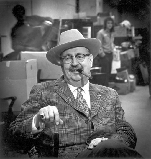 In March of 1972 Sam W. Pattison Rea, the smoke from his cigar curling over the brim of his hat, relaxes before the bidding starts at an auction. He has been in the auction business for 40 years. (Paul Hutchins/Baltimore Sun)