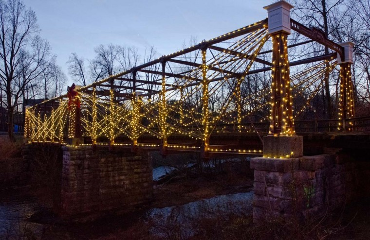 Bridge illumnation ends: A scene from the first-ever lighting ceremony for the Bollman Truss Bridge, an antique iron truss bridge in Savage, on December 7. The bridge will remain lit through January 7. (Photo by Nicole Martyn)