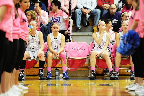 "One chair on the Mount de Sales ""bench"" is left open before a player sits down as the Pink Out game against Notre Dame Prep is about to begin. The event held, Friday, Jan. 31, 2014, raises money for breast cancer research. (Photo by Jon Sham/BSMG)"