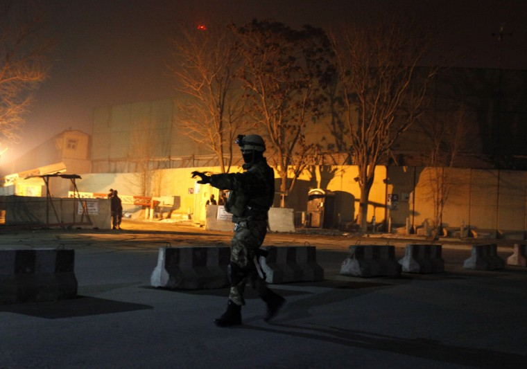 An Afghan security personnel keeps watch near the site of an explosion in Kabul January 4, 2014. A military convoy belonging to the NATO-led ISAF coalition force was bombed outside its base in Kabul's diplomatic quarter on Saturday, but no troops were hurt, security sources and ISAF said. (REUTERS/Mohammad Ismail)