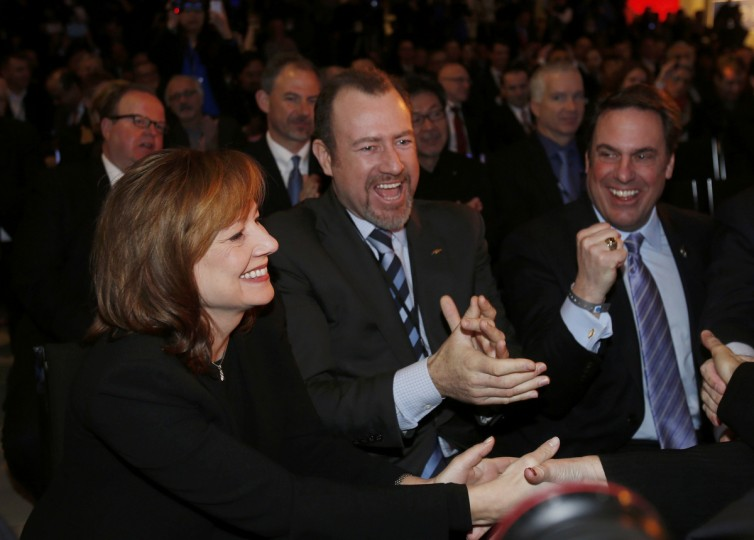 (L-R) GM CEO-designate Mary Barra, CFO Daniel Ammann and President of GM North America Mark Reuss celebrate after the Chevrolet Corvette Stingray won the Car of the Year Award during the press preview day of the North American International Auto Show in Detroit, Michigan January 13, 2014. (Rebecca Cook/Reuters photo)