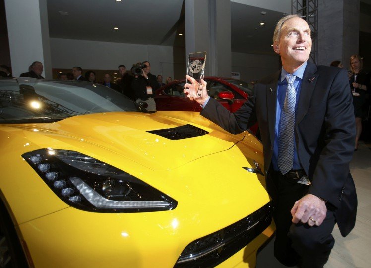 Tadge Juechter, chief engineer for the Corvette, poses with the Car of the Year Award next to a Chevrolet Corvette Stingray during the press preview day of the North American International Auto Show in Detroit, Michigan January 13, 2014. (Rebecca Cook/Reuters photo)