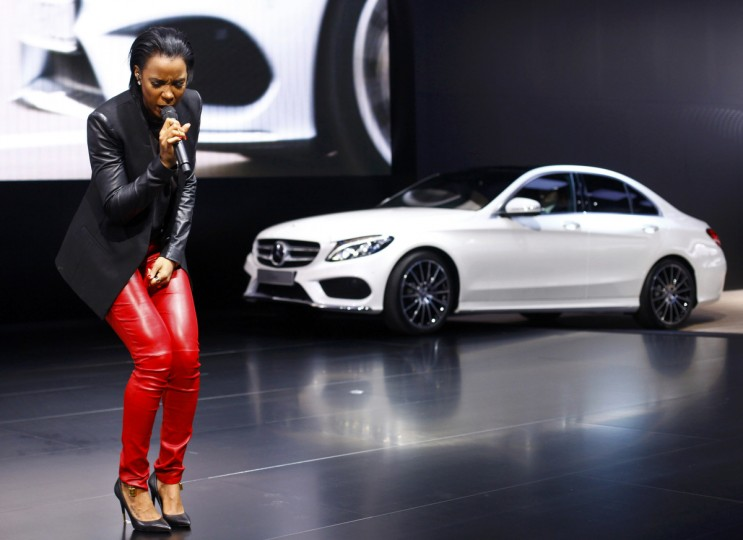 Singer Kelly Rowland performs in front of a C Class sedan during the Mercedes-Benz presentation at the press preview day of the North American International Auto Show in Detroit, Michigan (Joshua Lott/Reuters)