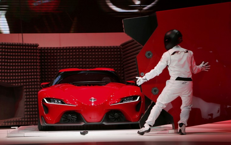 An actor performs as a Toyota FT-1 concept car is unveiled on stage during the press preview day of the North American International Auto Show in Detroit, Michigan January 13, 2014. (Rebecca Cook/Reuters photo)