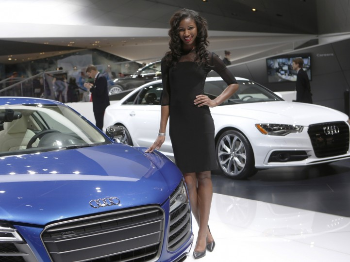 Model Vonnita Jones poses next to an Audi R8 during the North American International Auto Show in Detroit, Michigan. (Rebecca Cook/Reuters)