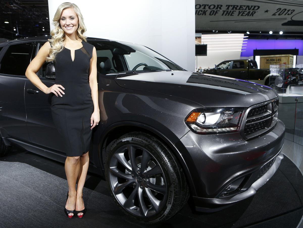 Model Poses Next To A Dodge Durango During The Press Preview - Durango car show