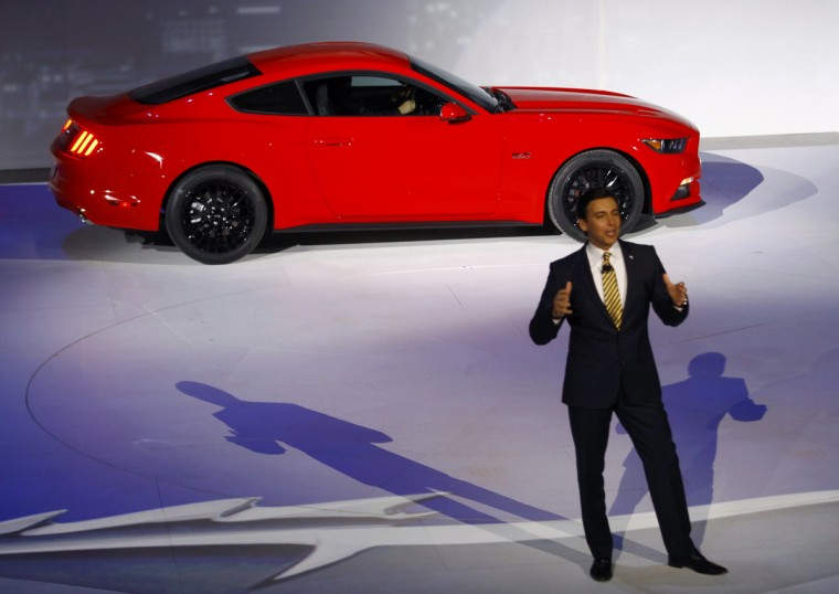Mark Fields, Ford Chief Operating Officer, speaks near a Ford Mustang during the press preview day of the North American International Auto Show in Detroit, Michigan January 13, 2014. (Joshua Lott/Reuters photo)