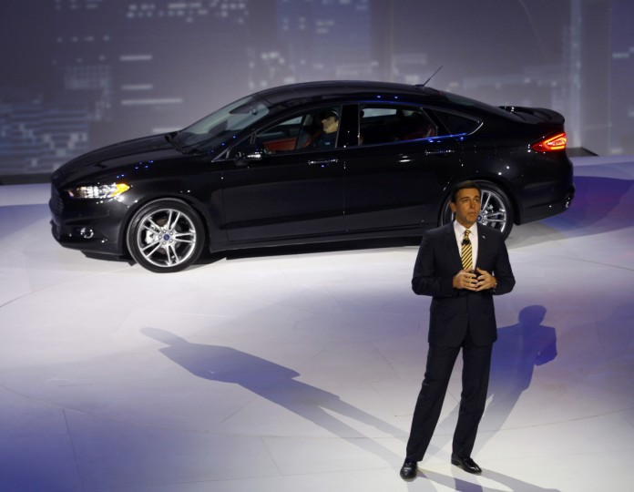 Mark Fields, Ford Chief Operating Officer, speaks near a Ford Fusion during the press preview day of the North American International Auto Show in Detroit, Michigan January 13, 2014. (Joshua Lott/Reuters photo)