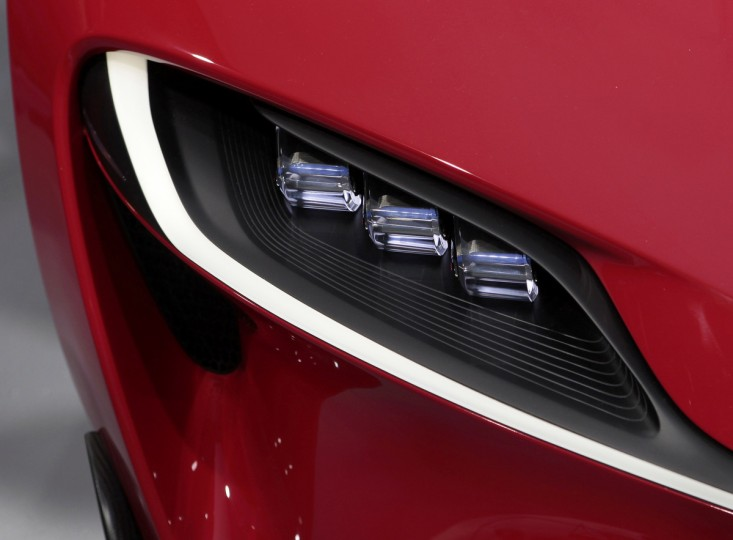 Detail view of a headlamp on the Toyota FT-1 concept car as it is unveiled on stage during the press preview day of the North American International Auto Show in Detroit, Michigan January 13, 2014. (Rebecca Cook/Reuters photo)