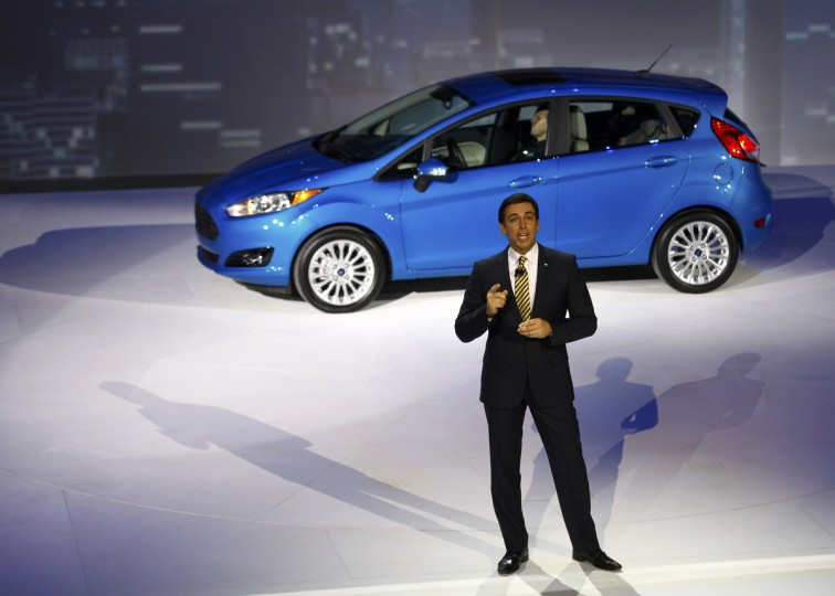 Mark Fields, Ford Chief Operating Officer, speaks near a Ford Fiesta during the press preview day of the North American International Auto Show in Detroit, Michigan January 13, 2014. (Joshua Lott/Reuters photo)