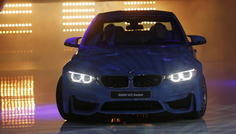 The BMW M3 sedan is rolled out during the press preview day of the North American International Auto Show in Detroit, Michigan. (Rebecca Cook/Reuters)