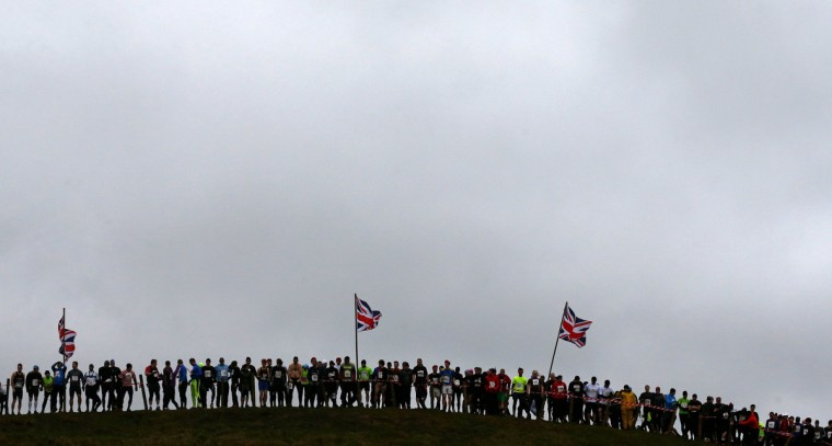 Competitors line up beneath Union flags as they wait for the start of the Tough Guy event in Perton, central England January 26, 2014. The annual event to raise cash for charity challenges thousands of international competitors in a cross country run followed by an assault course consisting of obstacles including water, fire and tunnels. (Darren Staples/Reuters)