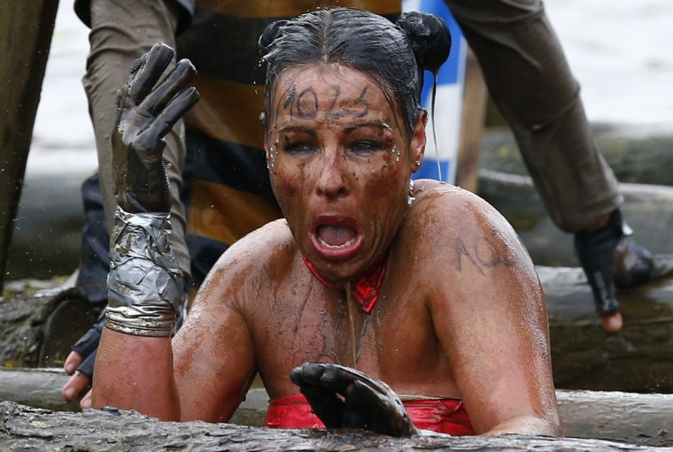 A competitor reacts as she emerges from the water during the Tough Guy event in Perton, central England, January 26, 2014. The annual event to raise cash for charity challenges thousands of international competitors in a cross country run followed by an assault course consisting of obstacles including water, fire and tunnels. (Darren Staples/Reuters)
