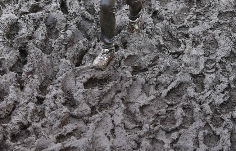 A competitor runs through mud during the Tough Guy event in Perton, central England, January 26, 2014. The annual event to raise cash for charity challenges thousands of international competitors in a cross country run followed by an assault course consisting of obstacles including water, fire and tunnels. (Darren Staples/Reuters)