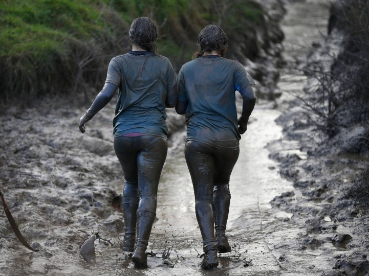 Competitors run through mud during the Tough Guy event in Perton, central England, January 26, 2014. The annual event to raise cash for charity challenges thousands of international competitors in a cross country run followed by an assault course consisting of obstacles including water, fire and tunnels. (Darren Staples/Reuters)