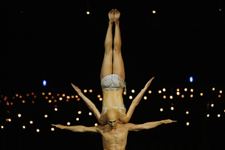 Artist Yves Decoste (bottom) balances Valentyna Sidenko on his shoulders during a dress rehearsal for Quidam, a show by Cirque du Soleil, at the Royal Albert Hall in London January 4, 2014. (REUTERS/Luke MacGregor)