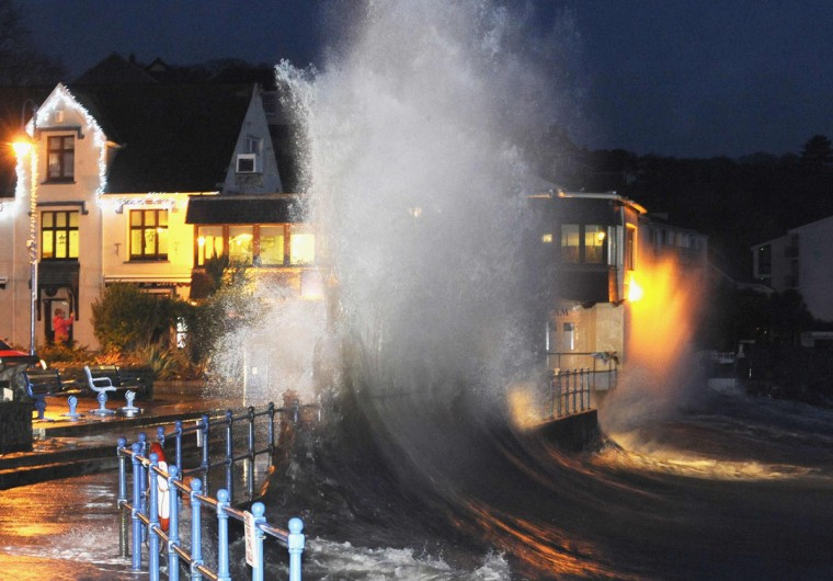 Waves crash over the promenade at hightide in Saundersfoot, in west Wales January 3, 2014. The south and west of the country was due to be hit by a combination of heavy rain, strong winds and high spring tides. Britain's Environment Agency said that there could be a threat to life. (REUTERS/Rebecca Naden)