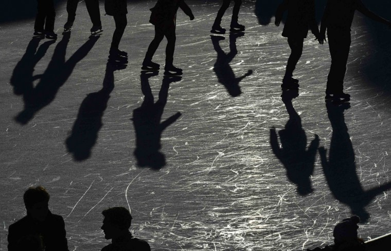 Visitors skate at the Tower of London ice rink in London January 2, 2014. Based in the grounds of the famous castle which is over a thousand years old, the temporary rink remains open until January 5. (REUTERS/Toby Melville)