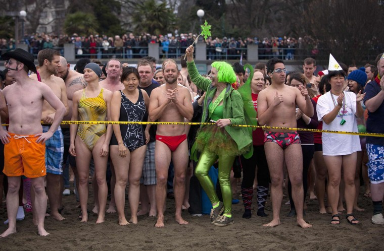 Participants prepare to run into English Bay during the 94th annual New Year's Day Polar Bear Swim in Vancouver, British Columbia on January 1, 2014. (REUTERS/Ben Nelms)