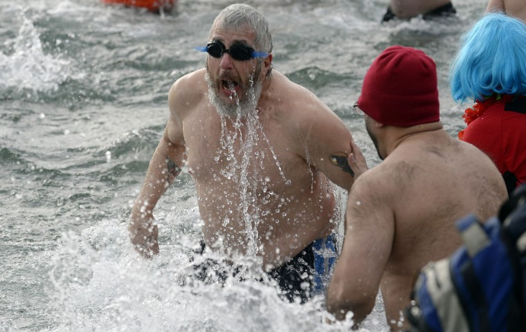 A man participates in the ninth annual Polar Bear Dip at Sunnyside Beach in Toronto on January 1, 2014. Hundreds of participants braved the icy waters of Lake Ontario to raise money for Habitat For Humanity. (REUTERS/Aaron Harris)