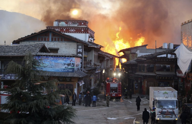 A firefighter truck is seen near a fire at the Dukezong Ancient Town in Shangri-la county, Yunnan province January 11, 2014. More than 1,000 people were battling the fire that broke out early Saturday at a resort county in southwest China's Yunnan province. Residents of the town were evacuated and no casualty has been reported at the moment, according to Xinhua News Agency. (REUTERS/Stringer)