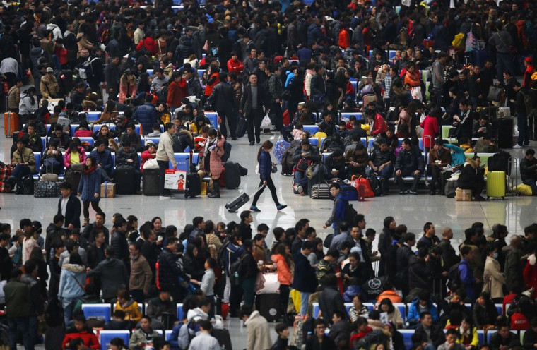 People wait for their trains at Hongqiao train station in Shanghai January 28, 2014. About 3.62 billion trips will be made during the 40-day Spring Festival travel rush which started from January 16, an official said, Xinhua News Agency reported. (Carlos Barria/Reuters)