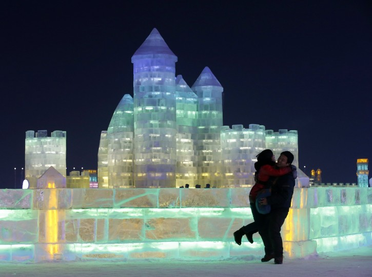 A couple shares an embrace in front of an ice sculpture at the Harbin Ice and Snow Sculpture Festival in the northern city of Harbin, China, January 5, 2014. (Kim Kyung-Hoon/Reuters)
